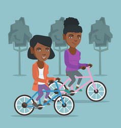 retired african women riding bicycles in park vector image