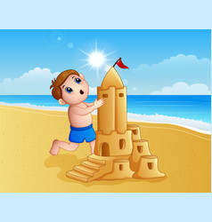 boy making a big sand castle at the beach vector image