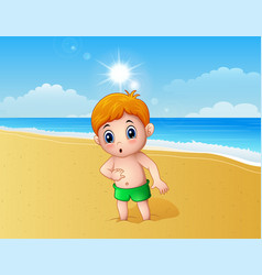 boy playing a sand using his feet at the beach vector image