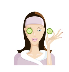 Girl does the mask of cucumber on the face vector image