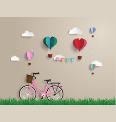 pink bikes parked on the grass vector image