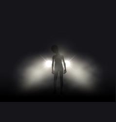 Alien in car headlights on foggy night vector