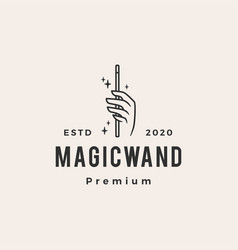 Hand magic wand hipster vintage logo icon vector
