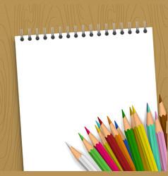 empty notebook with color pencils vector image