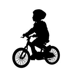 little boy silhouette riding a bike vector image