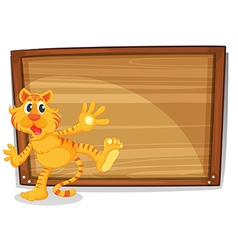A tiger in front of a blank board vector image
