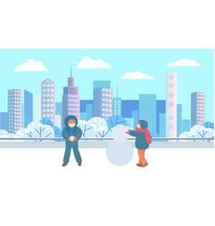 children sculpting snowman in winter city park vector image