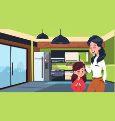 mother and daughter in modern kitchen over fridge vector image