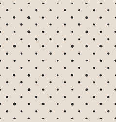 tile pattern with black polka dots on pastel pink vector image