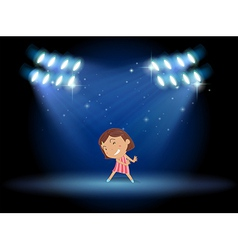 A little girl dancing in the middle of the stage vector image vector image