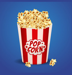 popcorn in a red striped bucket box vector image