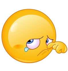 wiping tear emoticon vector image