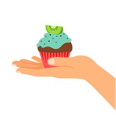 hand holding cupcake with kiwi vector image