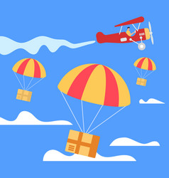 parachutes with boxes falling down from airplane vector image