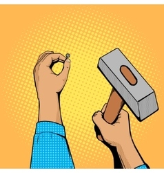 Hands with nail and hammer pop art vector