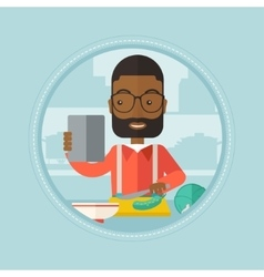 Man looking for salad recipe in tablet computer vector