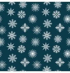 Seamless pattern snowflakes on blue background vector
