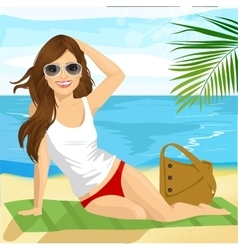brunette sunbathing on beach sitting on a towel vector image