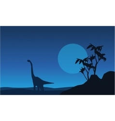 Silhouette of brachiosaurus at night landscape vector