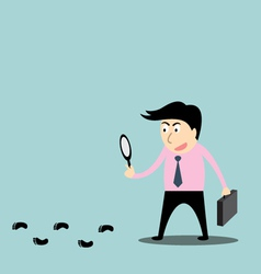 a detective following footprints vector image