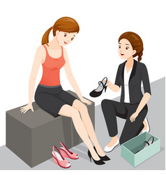 Saleswoman servicing woman customer vector