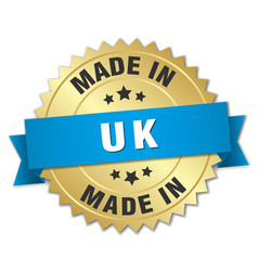 Made in uk gold badge with blue ribbon vector