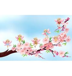 Fairies flying on blossom branch vector
