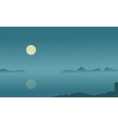 Silhouette of lake at night vector