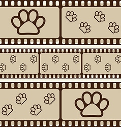 Retro background with film strips and pet paws vector image vector image