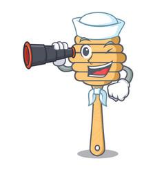 Sailor with binocular honey spoon mascot cartoon vector