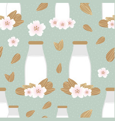 Seamless pattern with bottles of almond milk vector