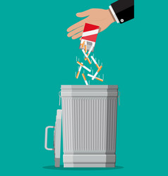Hand putting cigarettes package in trash bin vector