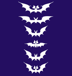 White silhouettes of bats vector