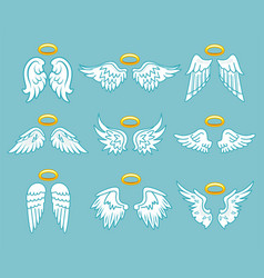 Angel white feather wings with nimbus set vector