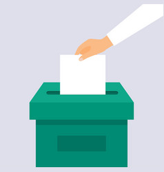 Hand puts voting ballot in ballot box election vector