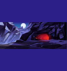 Entrance to cave in mountains at night vector