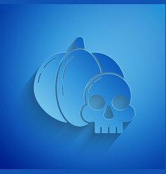 Paper cut pumpkin and skull icon isolated on blue vector