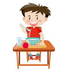 Boy eating from bowl on the table vector
