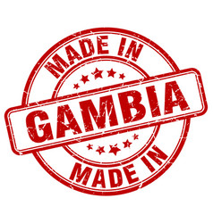 made in gambia red grunge round stamp vector image
