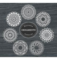 Set of 7 round decorative ornaments vector image