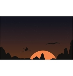 At sunset pterodactyl landscape of silhouettes vector image vector image