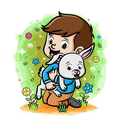 A boy playing with rabbit in garden vector