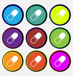 pill icon sign Nine multi colored round buttons vector image