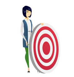 Young business woman and dart board vector