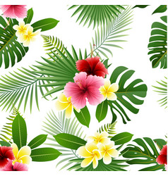 Seamless pattern of flowers and tropical leaves vector
