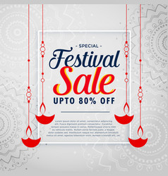 Festival sale background with hanging diwali diya vector