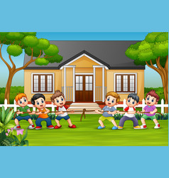 happy childrens playing tug war in front a hous vector image
