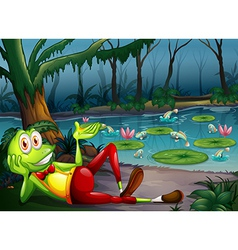 A frog in the forest resting near the pond vector image
