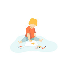cute boy sitting on floor and drawing with paints vector image