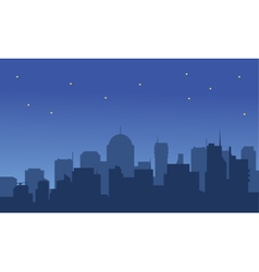 Silhouette of a big city at night vector